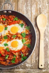 Shakshouka. Eggs poached in a tomato sauce with chilli peppers, onions and spices.