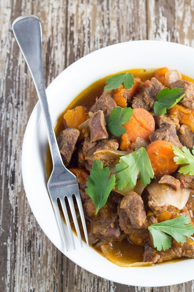 Slow Cooker Moroccan Lamb Stew. This meal is rich in flavour and so so tender, and very easy to make, meaning it's the perfect set-and-forget slow cooker meal.