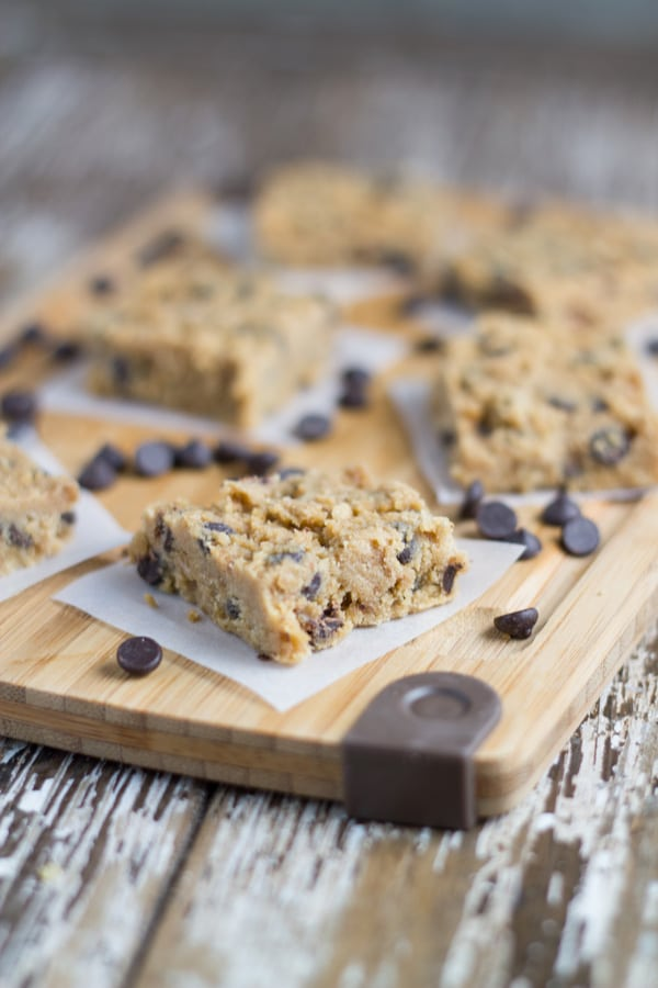 Raw Chocolate Chip Cookie Dough Bars. They are really easy to prepare, just mix the ingredients, spoon them into a lined square baking pan and place in the freezer to firm up.