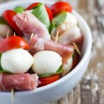 Prosciutto and Mozzarella Skewers (or Prosciutto and Bocconcini Skewers as they are called in Australia) are the absolute bomb diggity. They are the perfect appetizer for Christmas or any celebration.