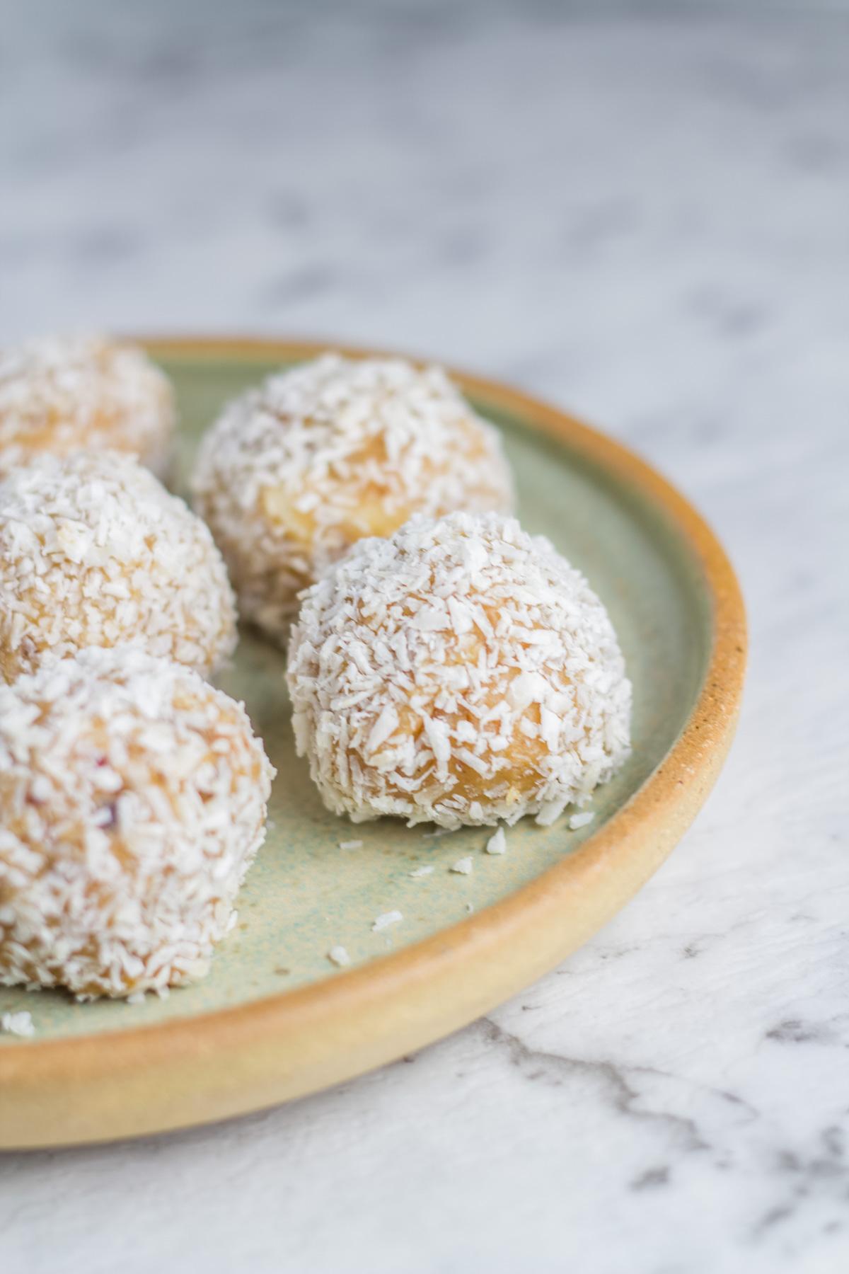 plate with raw caramel macadamia bliss balls