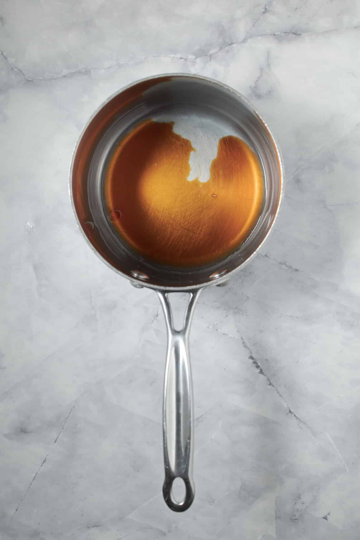 photo of the coconut oil and maple syrup heated up in a saucepan