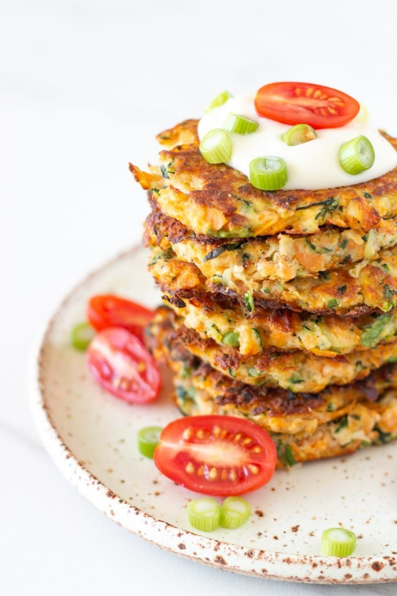 These healthy zucchini and sweet potato fritters are packed full of flavour and are super easy to make. Includes a vegan option.