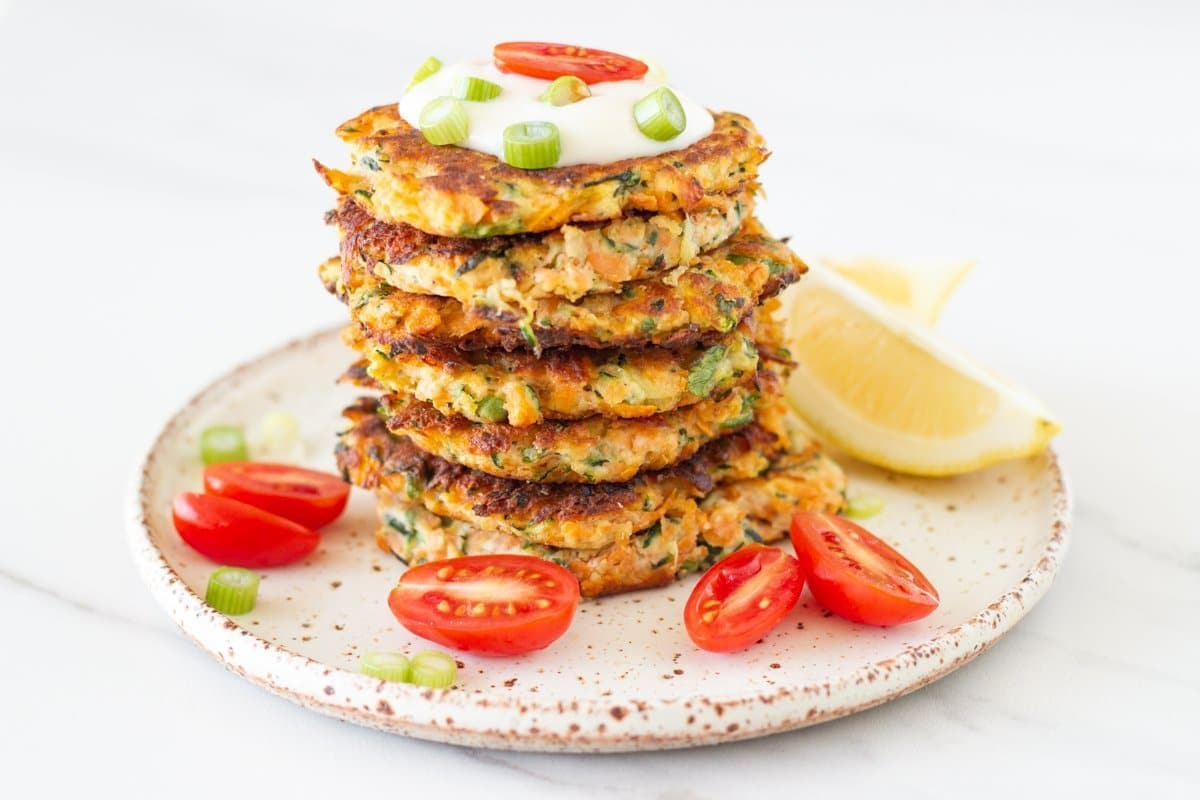 These healthy zucchini and sweet potato fritters are packed full of flavour and are super easy to make. Includes a vegan option
