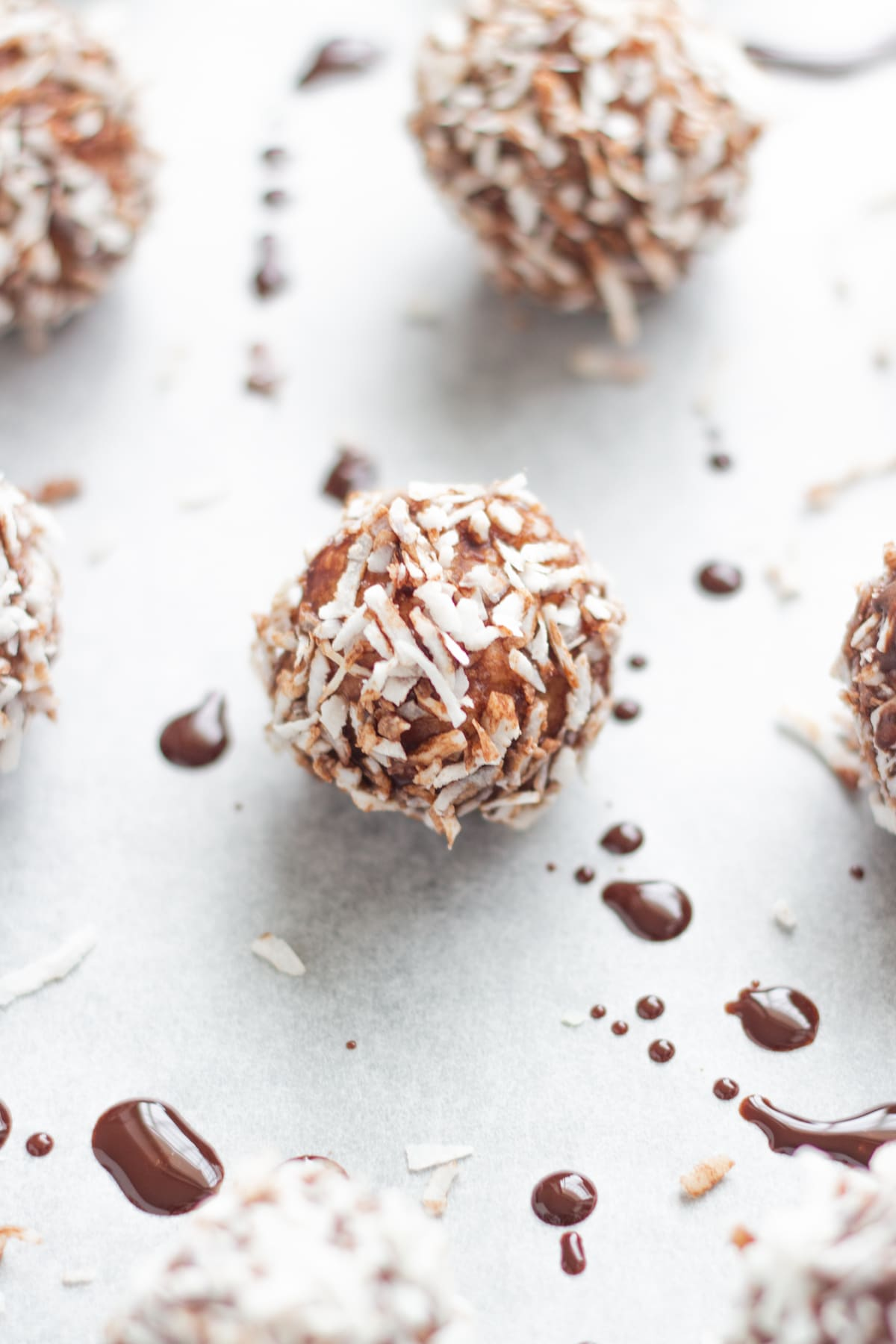close up of lamington bliss balls on a baking tray lined with baking paper