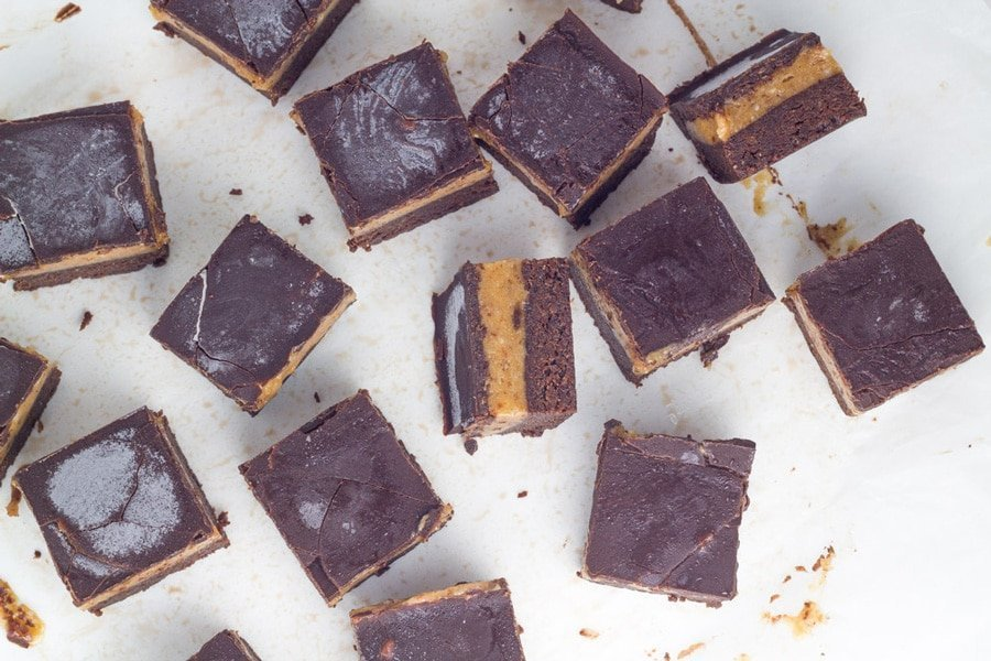 Photo of several pieces of the raw caramel brownie slice
