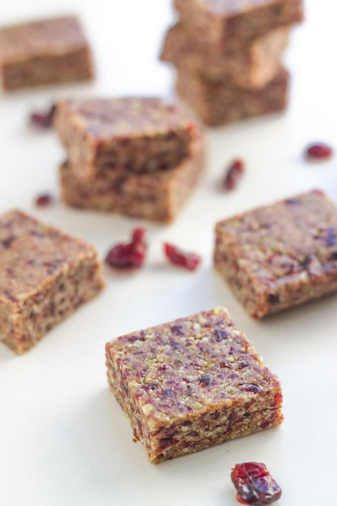 Raw Cranberry Date Bars are super easy to make and make the perfect travel snack or to put in your child's lunch box.