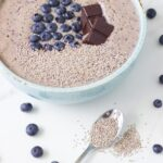 This amazing vanilla blueberry smoothie bowl is topped with chia seeds and organic dark chocolate. Who said Breakfast had to be boring!