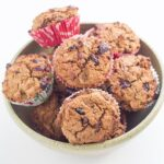 These spiced Christmas Muffins are made with cranberries, pecans and flavoured with orange essential oil. nutmeg and cinnamon. The flavour is amazing!