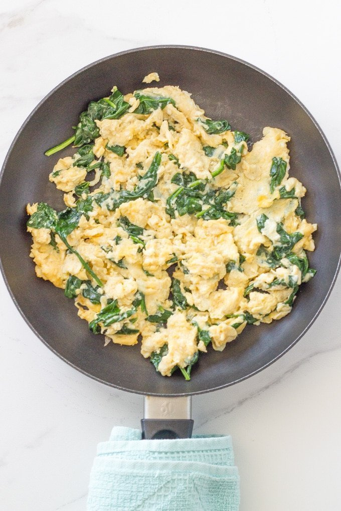 Super easy spinach scrambled eggs is one of my favourite go-to breakfast recipes. It is keto and low carb friendly and only takes a few minutes to make.