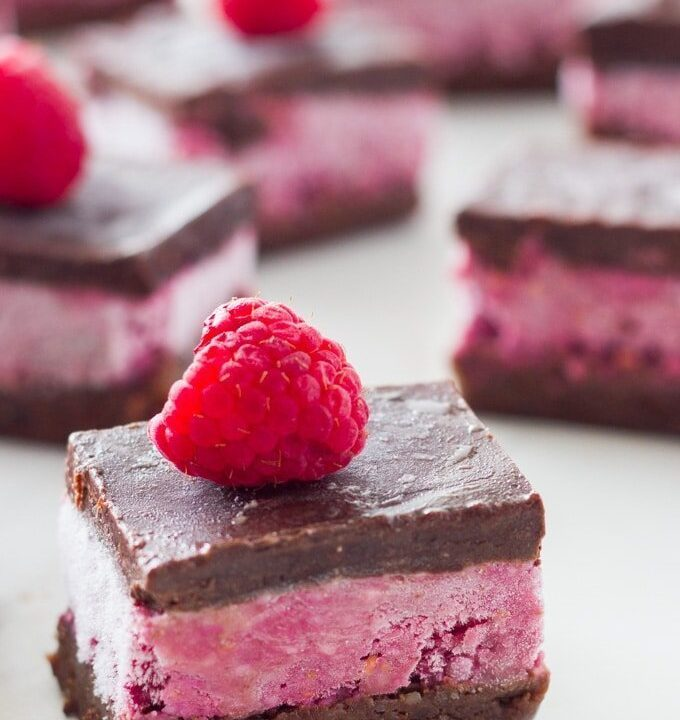 These Raw Chocolate Raspberry Brownies will become your favourite raw dessert! These brownies are made up of three layers that go so beautifully together - the 'chocolatey' brownie base, the 'gorgeous' raspberry layer and to top it off a layer of raw chocolate. |