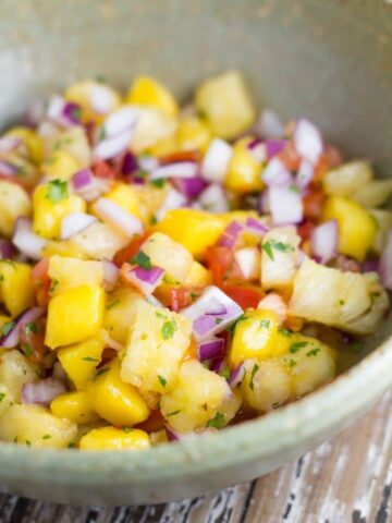 This mango pineapple salsa is sure to be a hit at your next summer bbq. It also works amazingly with mexican food or chicken, fish or pork dishes.