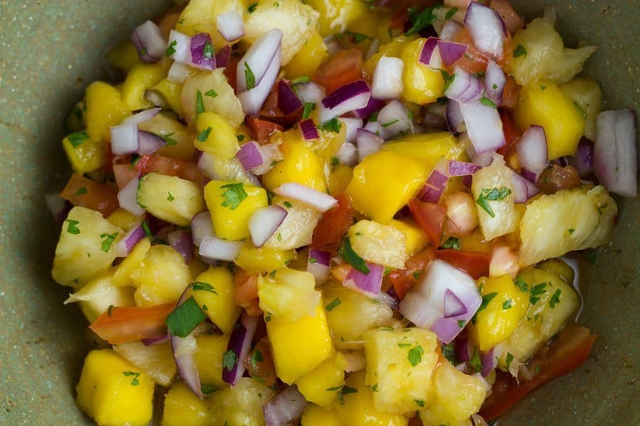 This mango pineapple salsa is sure to be a hit at your next bbq. It also works amazingly with mexican food or chicken, fish or pork dishes.