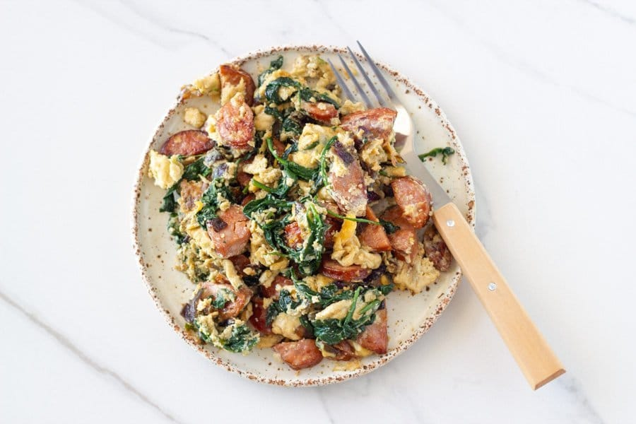 This delicious chorizo egg scramble makes the perfect breakfast or brunch. It combines eggs, chorizo, baby spinach and red onion in this easy to make one-skillet meal.