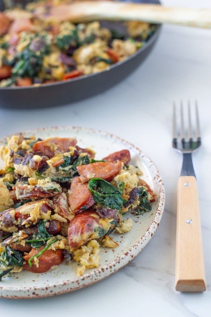 plate of chorizo egg scramble and fry pan with the rest of the chorizo egg scramble
