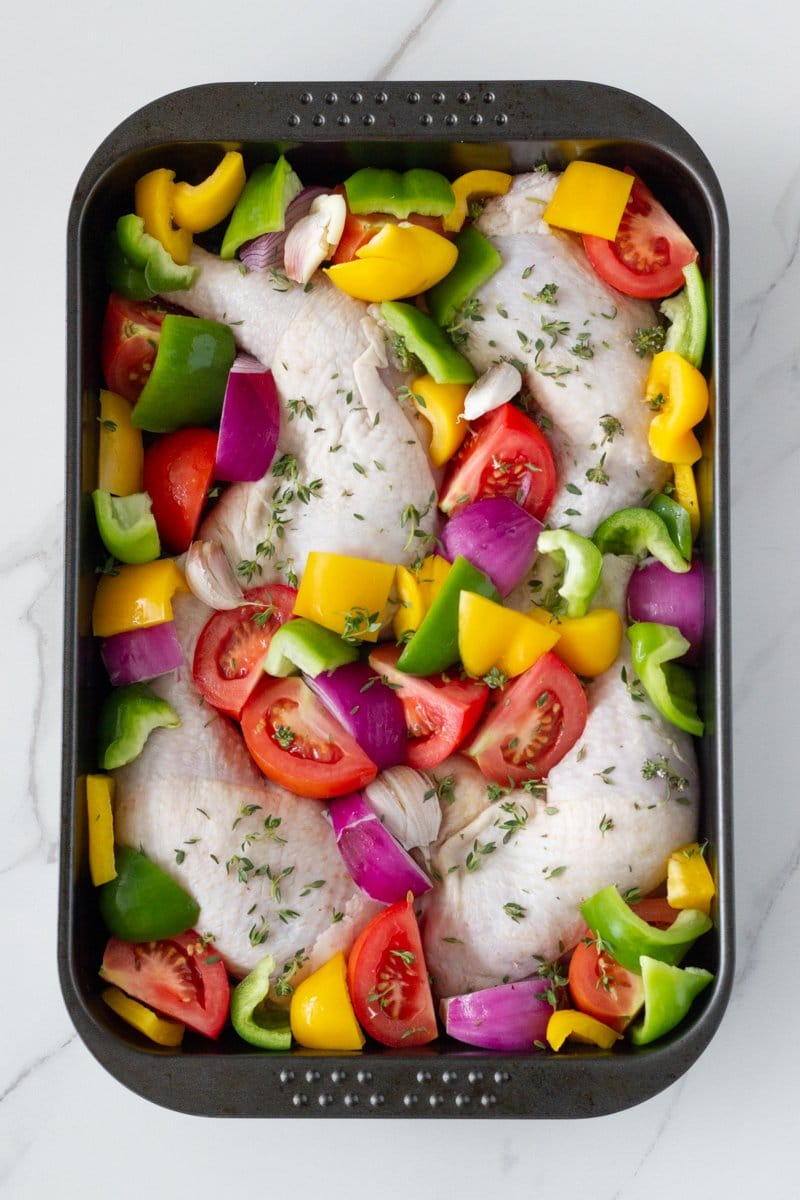 One tray oven baked chicken and vegetables is your weekly go-to roast chicken dish. This easy to make one pan dinner is made with a delicious marinade and easy to prep vegetables.