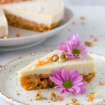 a photo of piece of the Raw Carrot Cake with Macadamia Frosting with the cake in the background