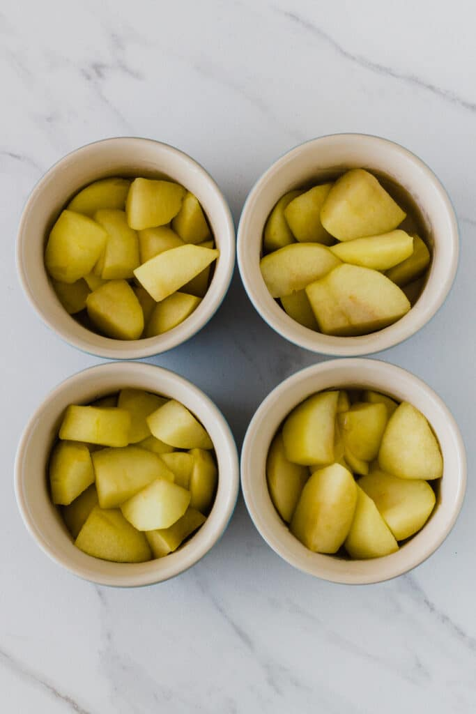 photo of cooked apple mixture divided among 4 ramekins