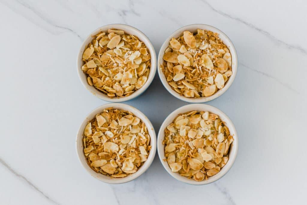photo of 4 ramekins with the baked apple crumble