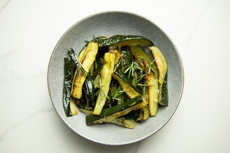 bowl of oven baked zucchini wedges