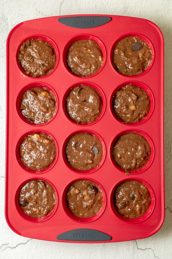 photo of silicone muffin tray with mixture added evenly among the 12 muffin sections