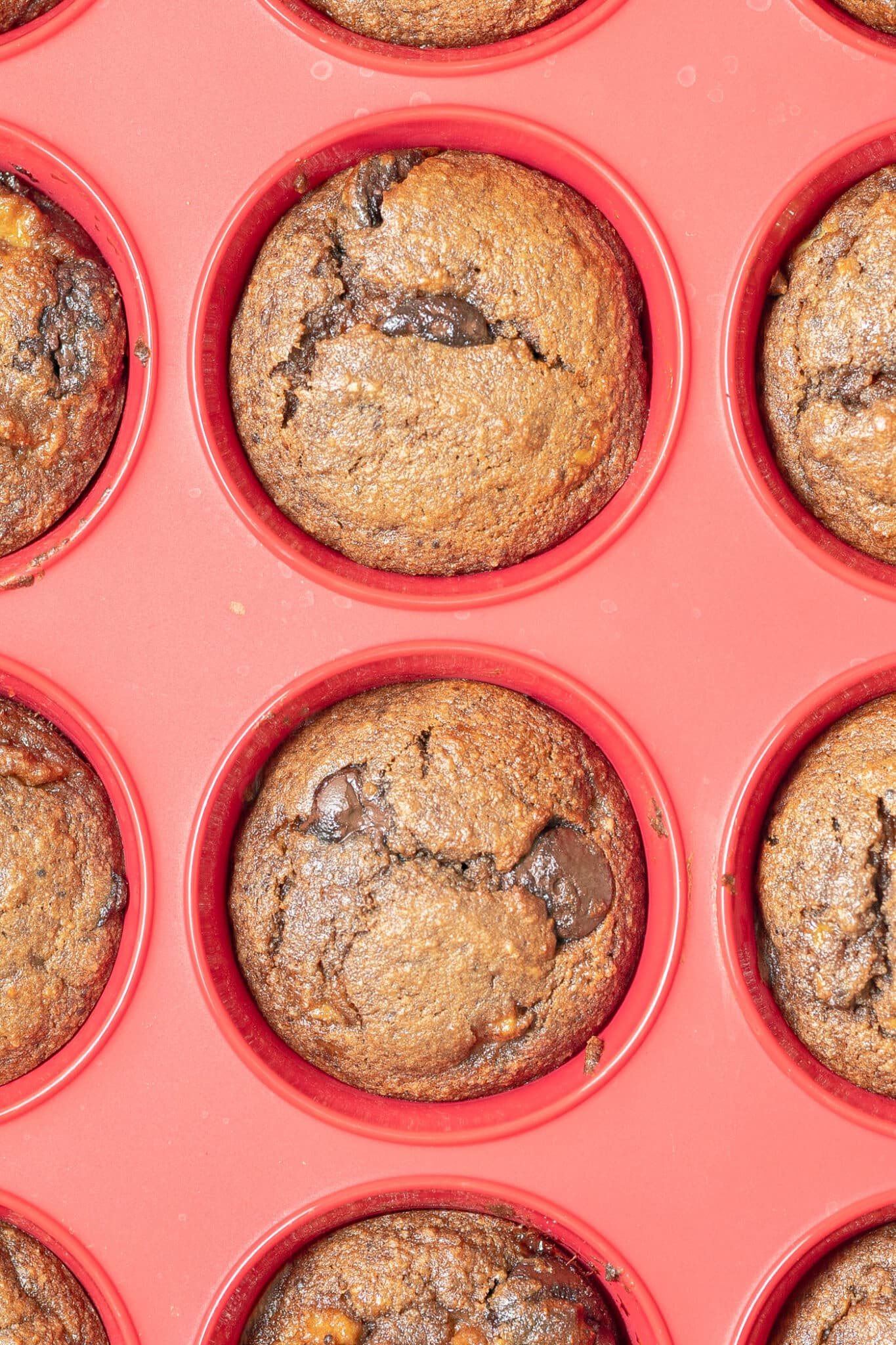 close of photo of the cooked double chocolate banana muffins in the silicone muffin tray